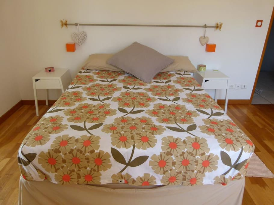 This is the main bedroom, with double bed, views overlooking garden and swimming pool