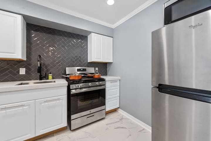 All cookware, stove and stainless steel fridge