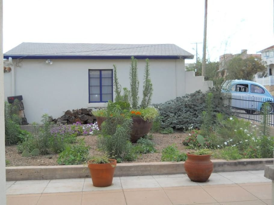 The Studio building with private parking and our front yard.