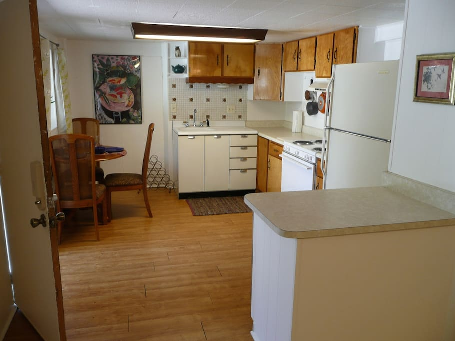 Kitchen includes all cooking and dining amenities