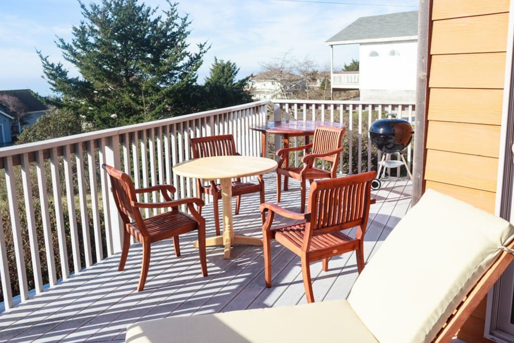 Patio furniture set with table and chairs and 2 chaise lounges