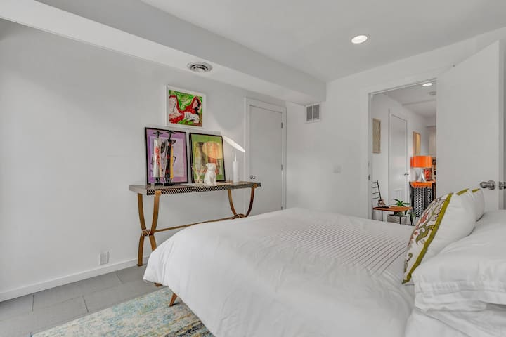 Redesigned lower level bedroom with private patio and access to the gardens.