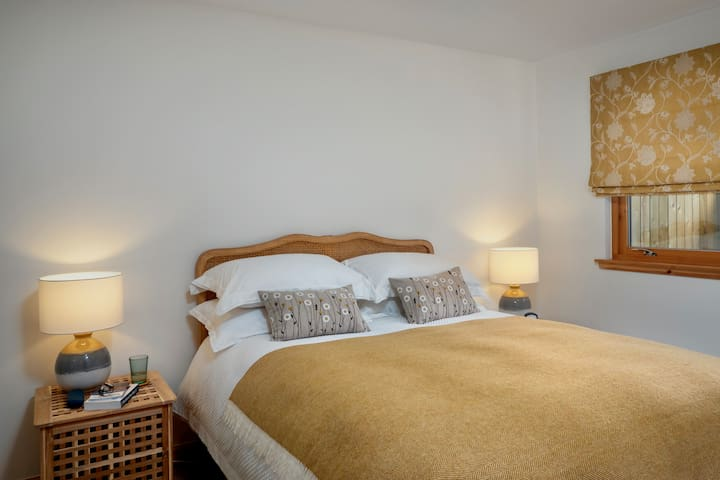 The main bedroom has a comfortable kingsize bed and spacious fitted wardrobes for storage