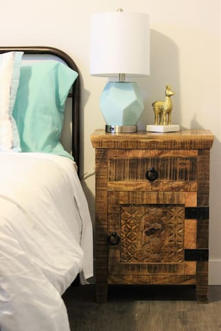 Second bedroom with cute lighting and bedside tables