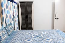 Comfortable double bed and cupboard for your belongings