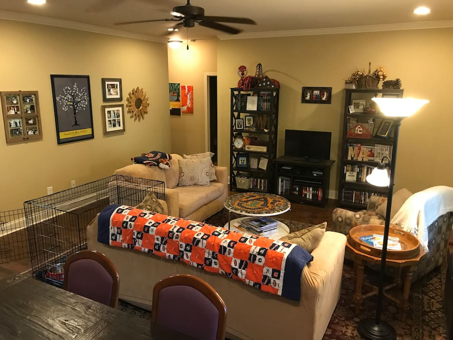 The living room: ample seating in an open concept. A sofa, love seat, and chair make for easy relaxation. If you are bringing a dog, no need to haul a crate - this room has an extra large one! It collapses as well, so if you'd rather have more space we can take it down.