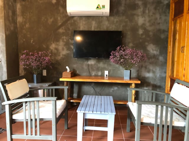 Cozy vintage style furniture. Room with inverter - air conditioner, Smart TV and fridge