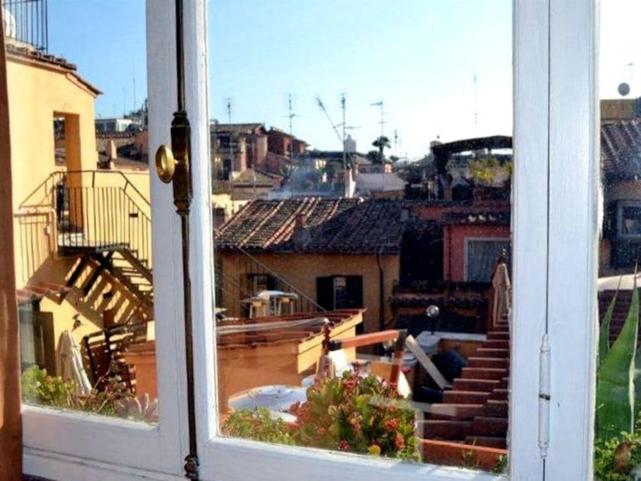 Roman holiday view, overlooking terracota rooftops. View from the back.