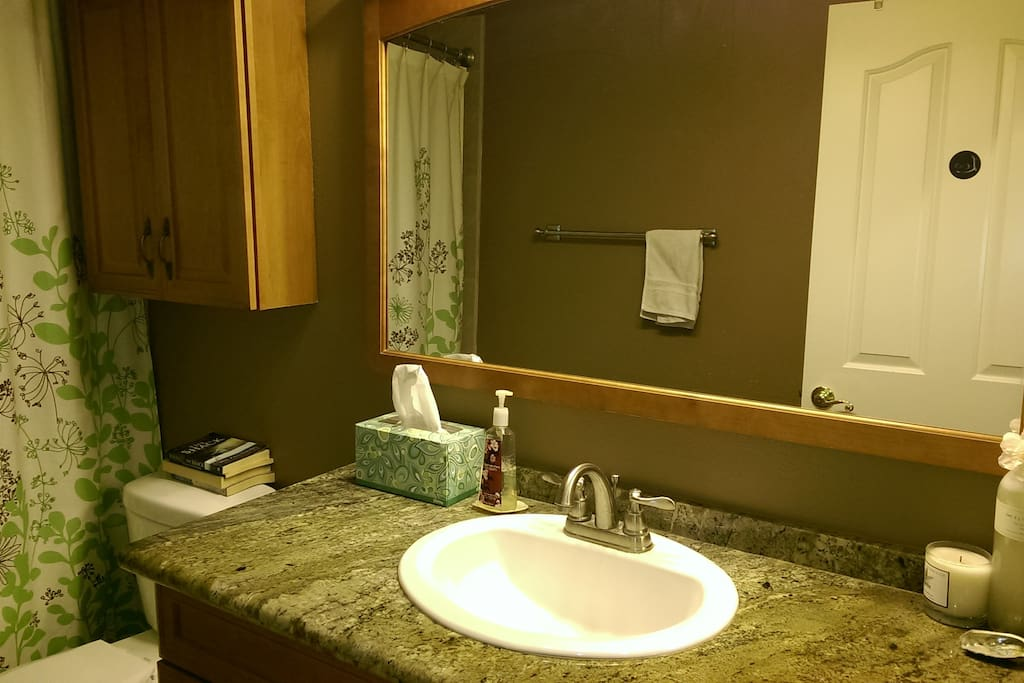 Remodeled bathroom with granite counter top, soap/shampoo/towels provided