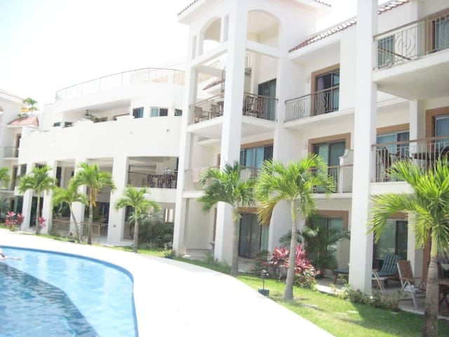 Condo is on 2nd floor at right overlooking pool all 3 balconies