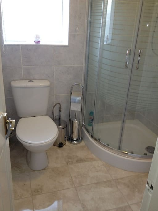 Newly refurbished bathroom with shower.