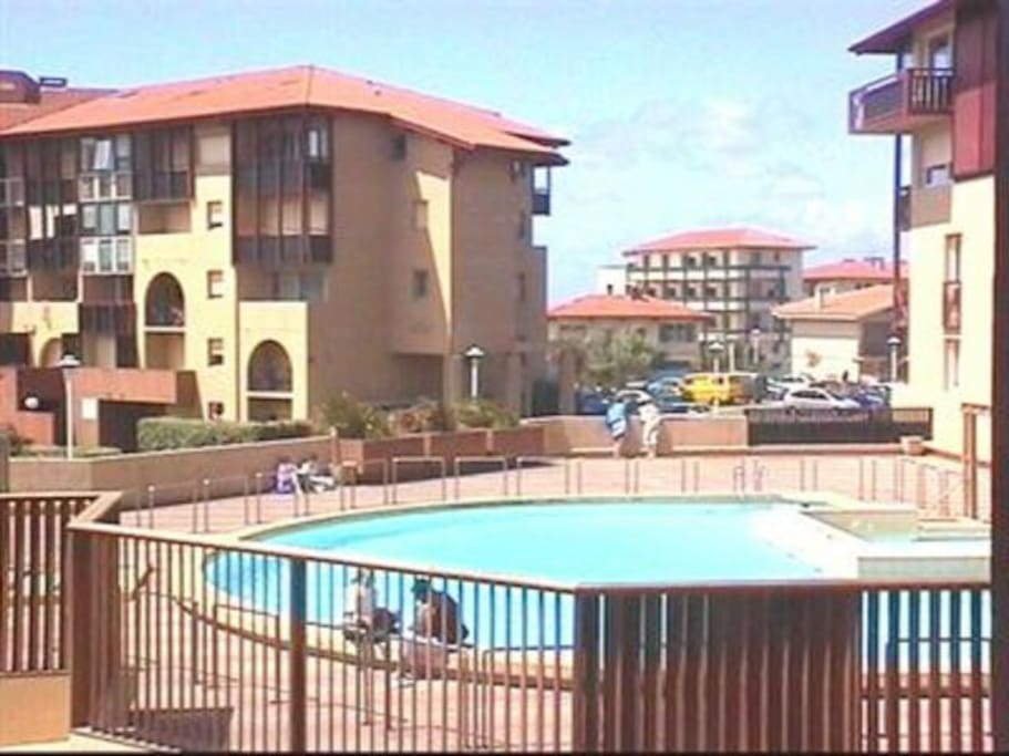 The building with the pool is where you park