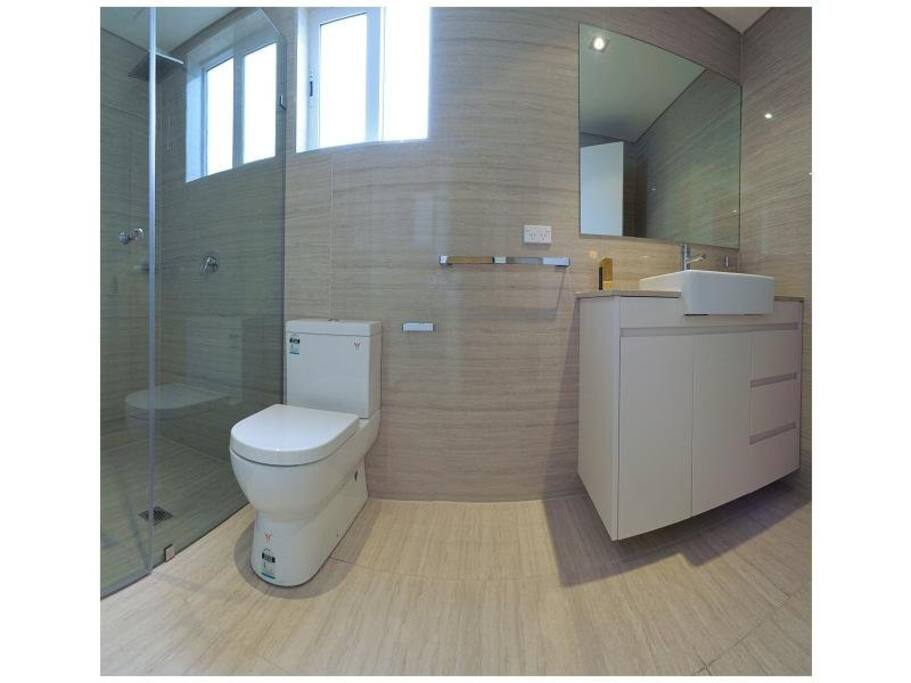three bathrooms with shower and  WC