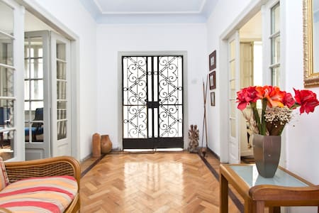 Our house is a charming art Deco townhouse in Laranjeiras. Wonderfully located, near all touristic points of Rio and public transportation. Clear environment, bedrooms comfortably hosts 2 or 3 people in each room, well appropriate shared bathrooms.