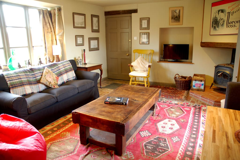 the Living room, showing woodburner & front door