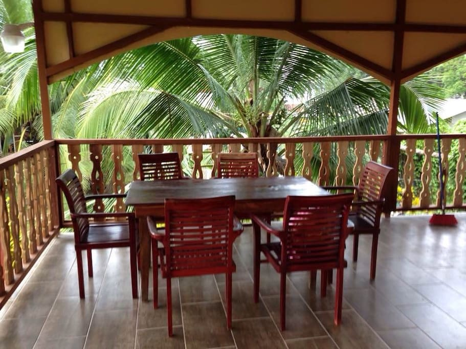 Balcony dinning area with sea breeze and beautiful view of the Sea through the palm trees !