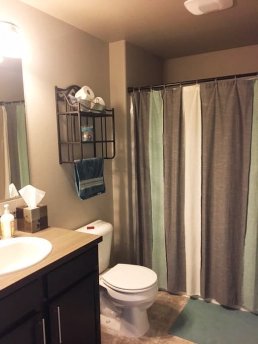 Private bathroom with shower and tub directly next to bedroom