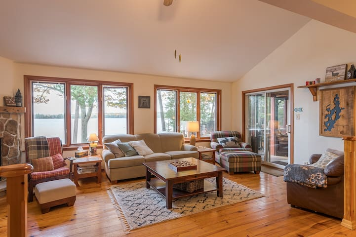 Sunken living room with gas fireplace, overlooking the lake