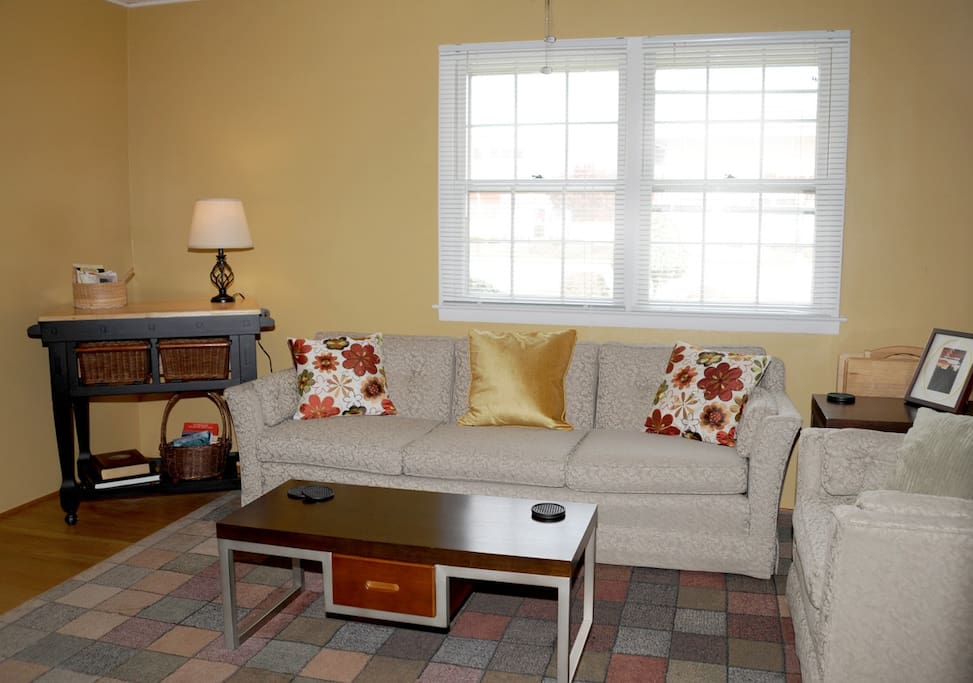 The living room is a great place to wind down after the day, watch DVDs or read a good book. We're often told this is the most comfortable couch our guests have ever sat on!