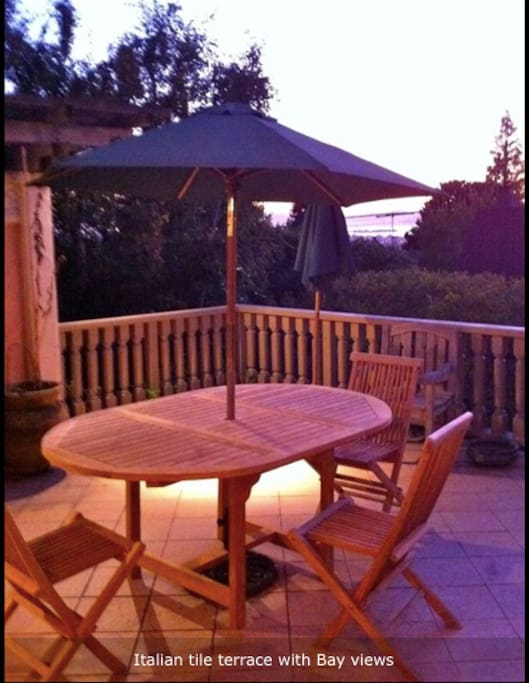 Tiled terrace with bay views, fine lighting for evening meals