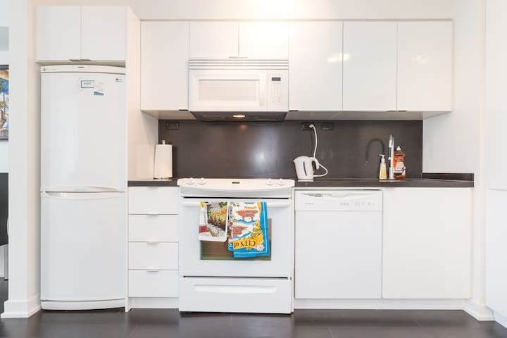 Full Kitchen including dishwasher, microwave, Tea kettle, all pots and pans.