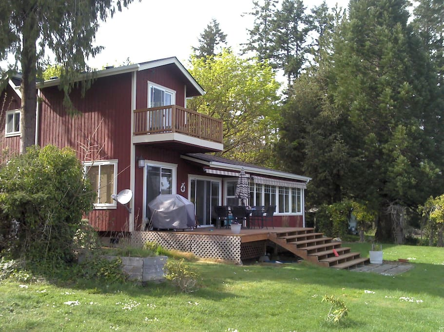 Spacious back deck, level grassy lawn to the beach. Master bedroom balcony upstairs.