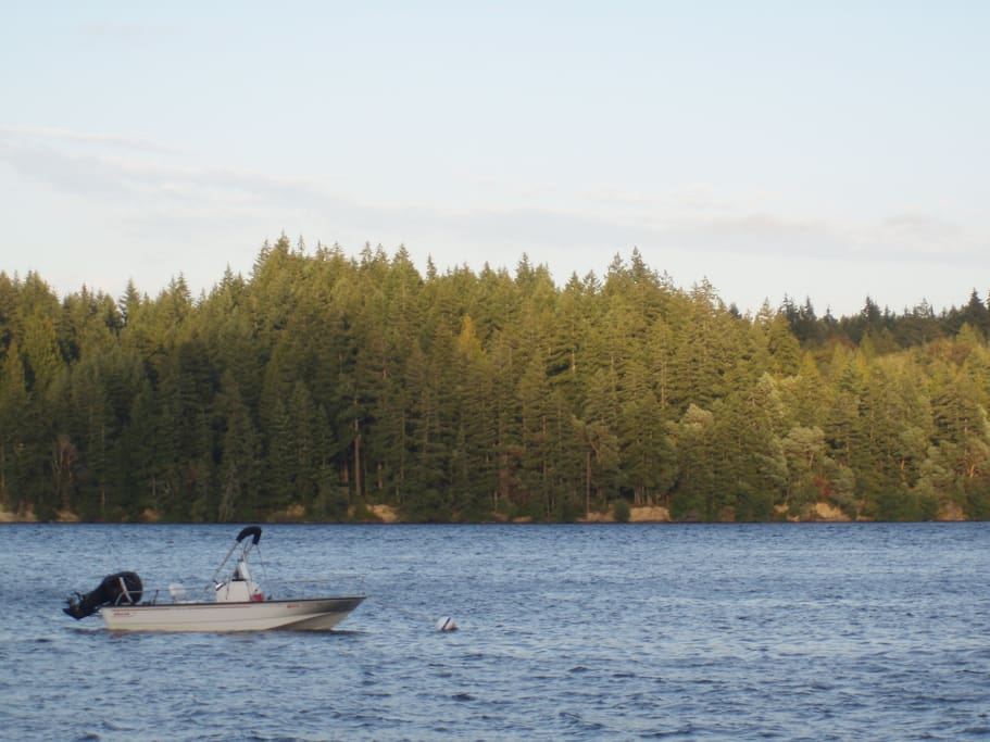 View across water. Our Boston Whaler on the mooring buoy for the night.