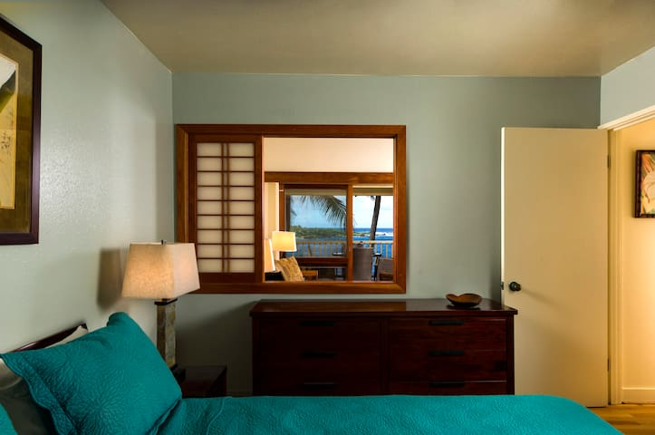 Bedroom with partition window for air circulation and view