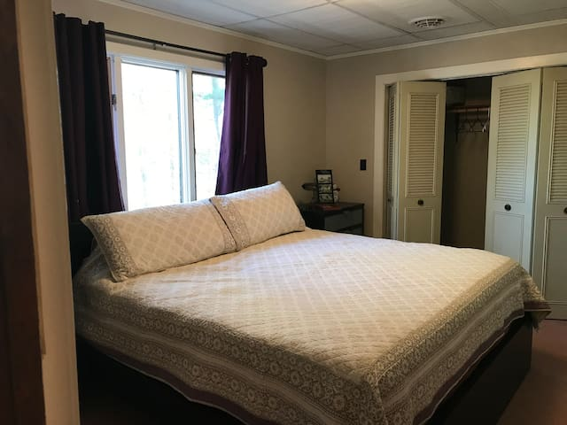 The bedroom at the top of the stairs boasts a king bed and it's own door into the newly remodeled bathroom