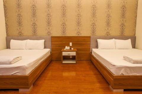 Spacious Deluxe Room at Trieu Khang Hotel