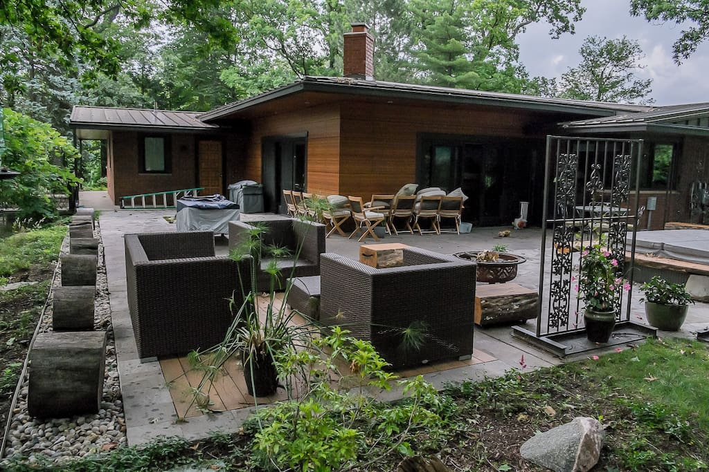 Entertaining patio with concrete, inlaid trex, hot tub, sound system, and grill.