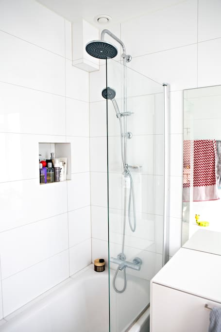 main bathroom with large mirror, bath and shower and underfloor heating.