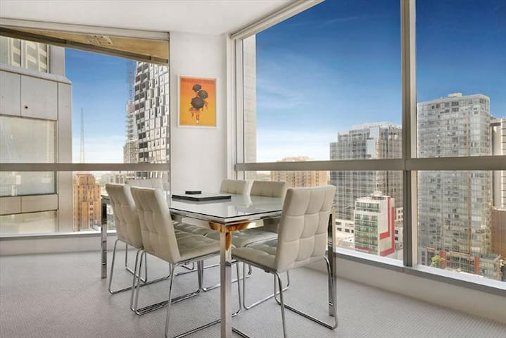 Spacious dining area with marble-top table and really comfy chairs; and magnificent views over the city!