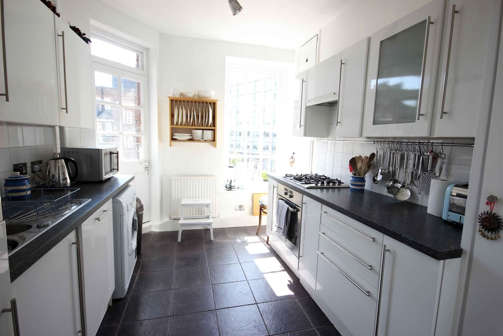 The well equipped kitchen includes a dishwasher, washer/dryer, fridge freezer and microwave.