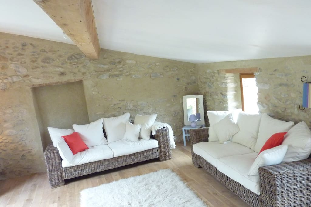 Sitting room sympathetically renovated retaining all the charm that exposed stone walls and old beams can bring.