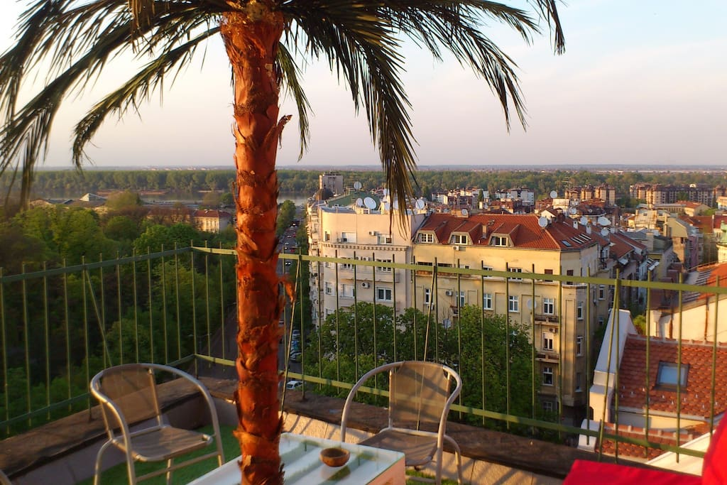 Terrace with perfect view on Kalemegdan Park / Fortress, Danube river, and historical part of city.