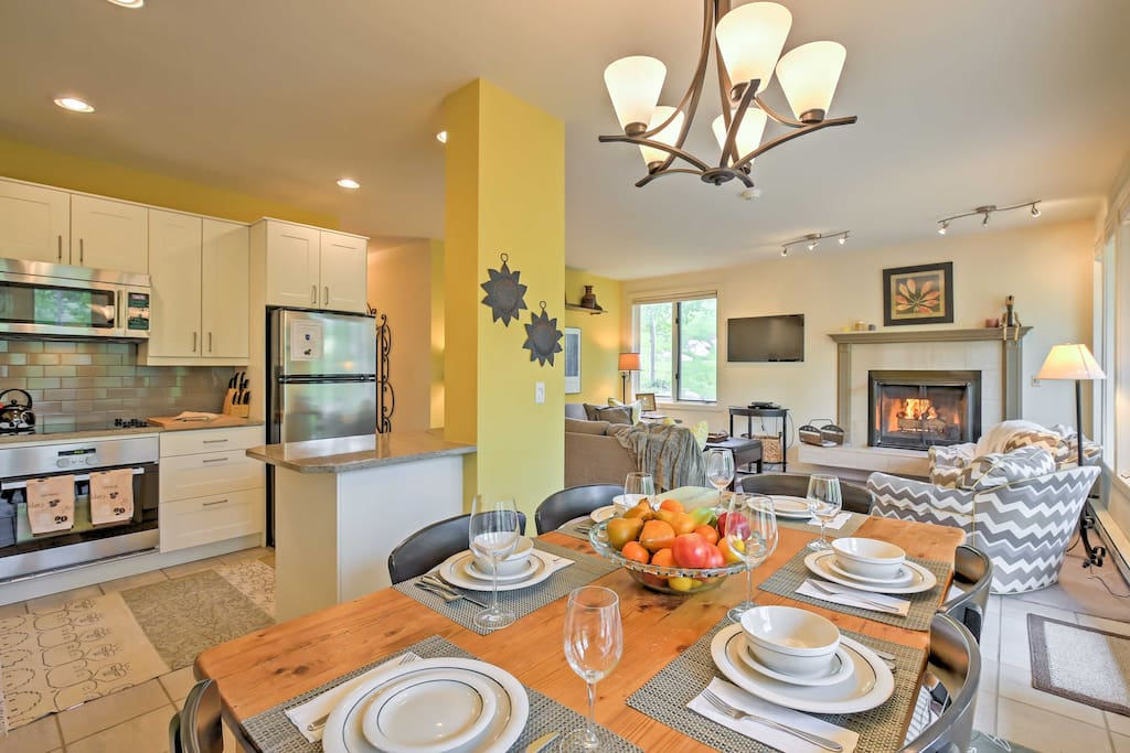 The open-concept layout includes stylish decor and high-end appliances.