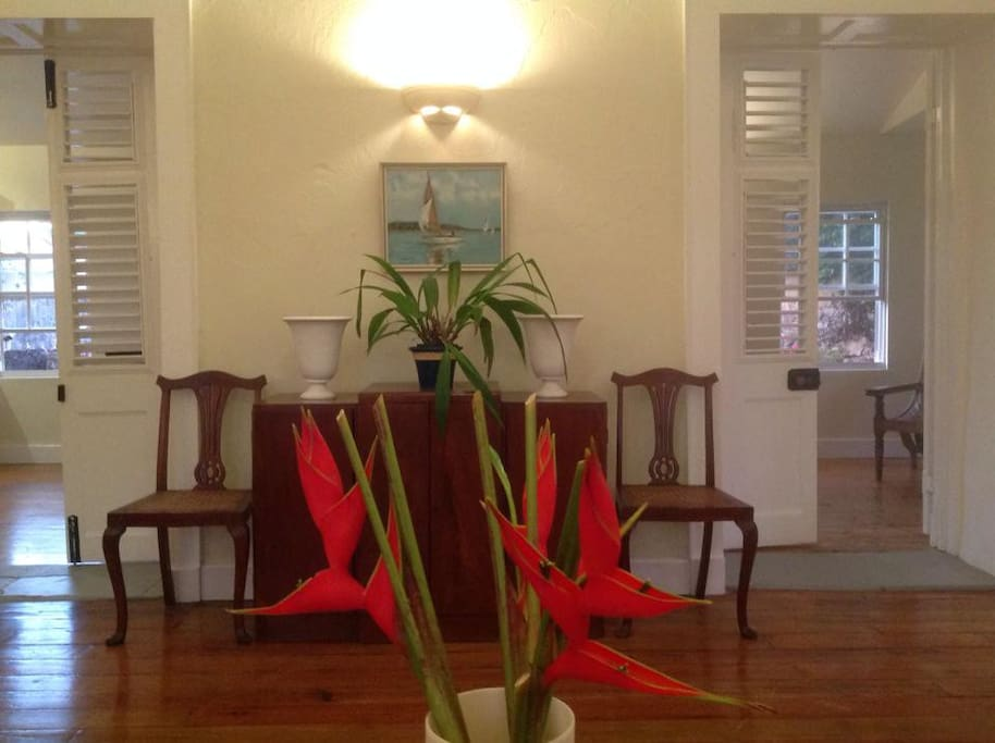 Fresh tropical flowers are placed in the living-room for all arrivals