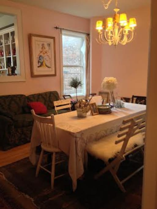 Lots of room to relax around the table - and window through to the kitchen allows the chef to be a part of the fun