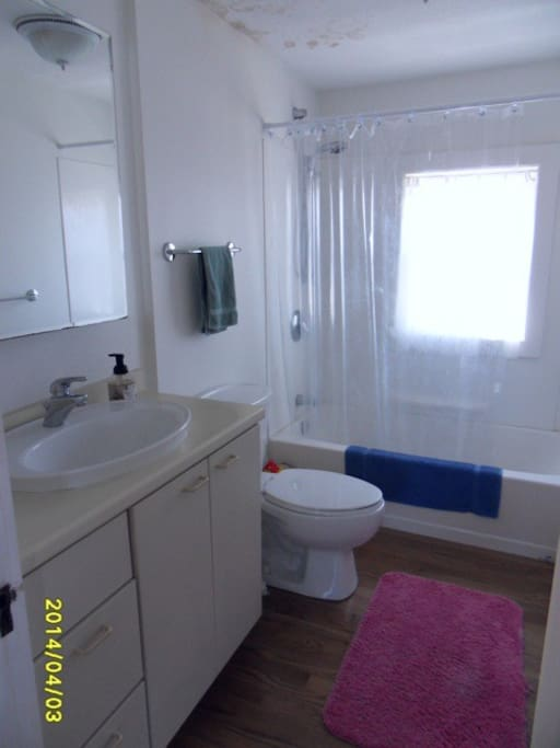 Bright and airy upstairs full bath with tub/shower.