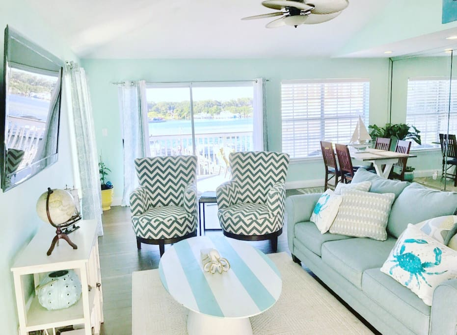 Wake up with a water view and lounge in a spacious living space.