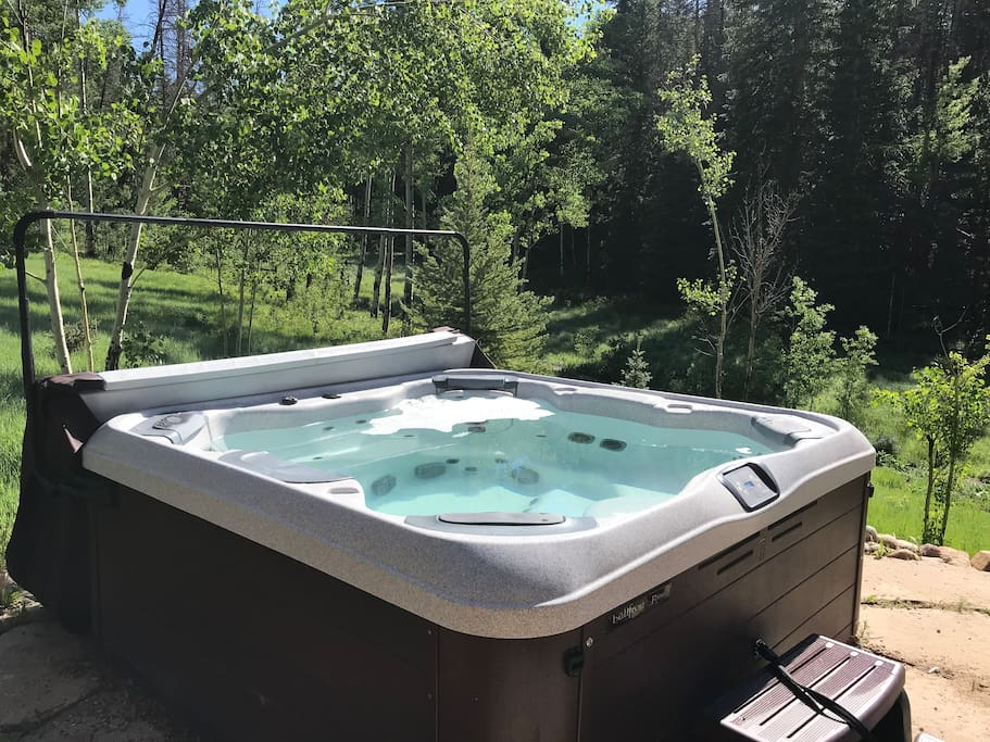 Private hot tub is steps away from the house and surrounded by nature. Great view of Winter Park Resort and mountains.