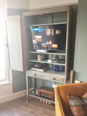 Vintage Cabinet, discreetly housing a TV, Free Sat & Apple TV.