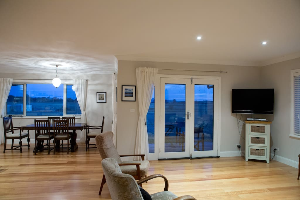 Lounge, Dining table and TV, looking towards our french doors on to the verandah and the view to Salisbury Hill