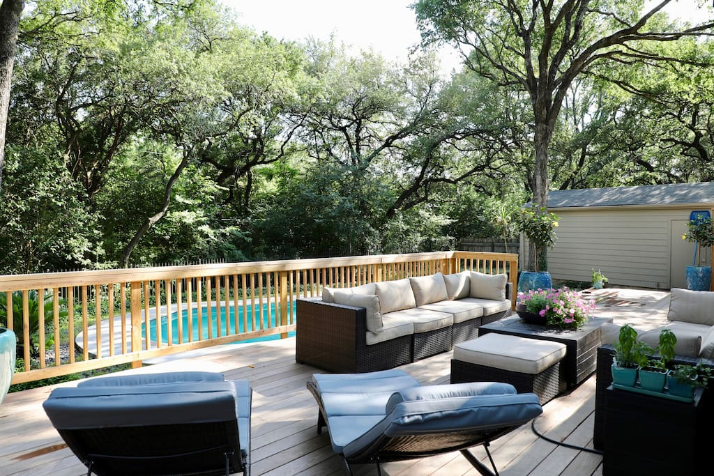 Tons of outdoor relaxation space to enjoy the pool and canopy of trees.