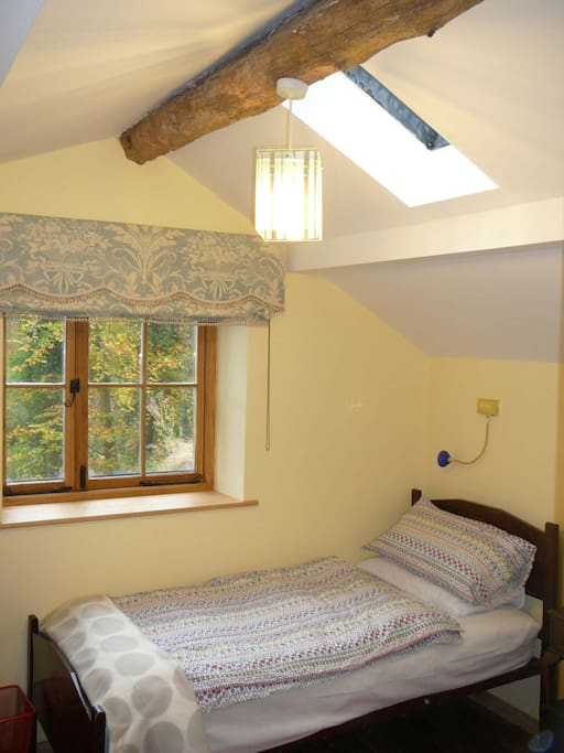 Twin bedroom with views over pond and garden