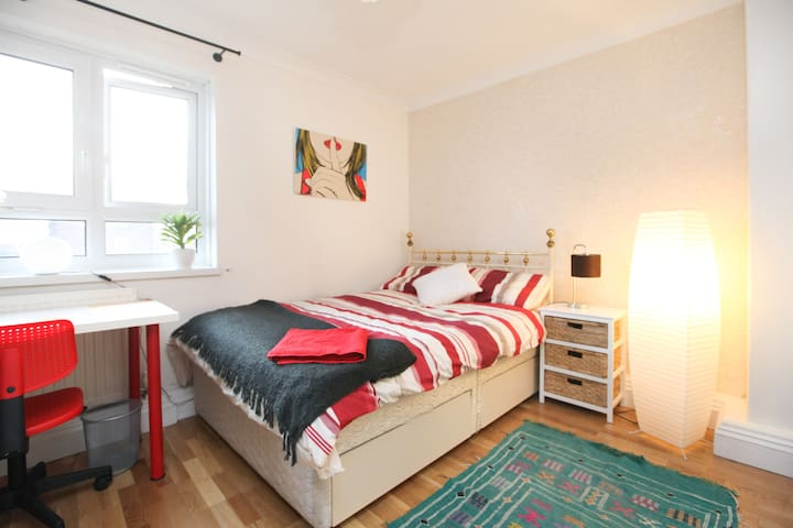 Double room with double bed facing communal garden