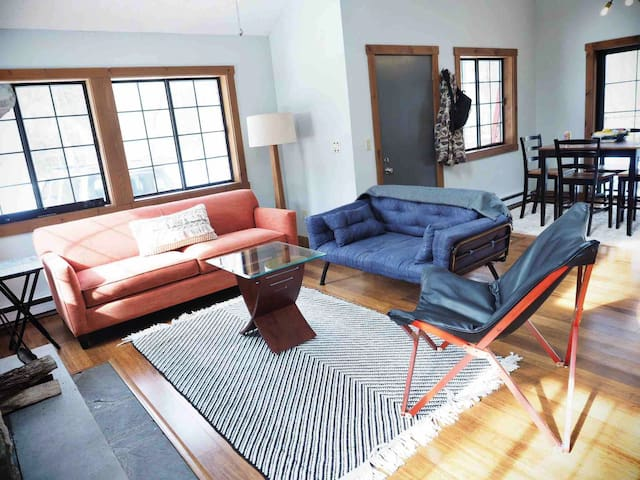Open living concept with vaulted ceilings, bamboo floors & modern decor