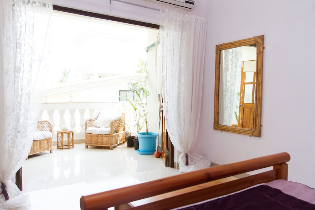 Comfortable ,light and airy bedroom with air con and ceiling fan