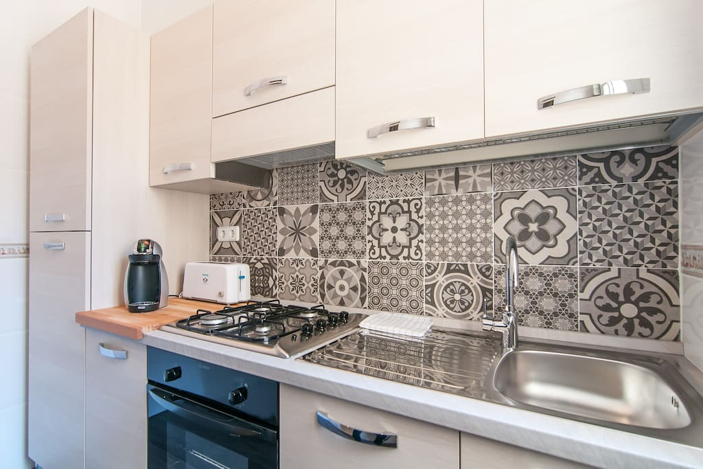 Classic mosaic tiles of Barcelona brighten the kitchen and inspire cooking your own tapas.